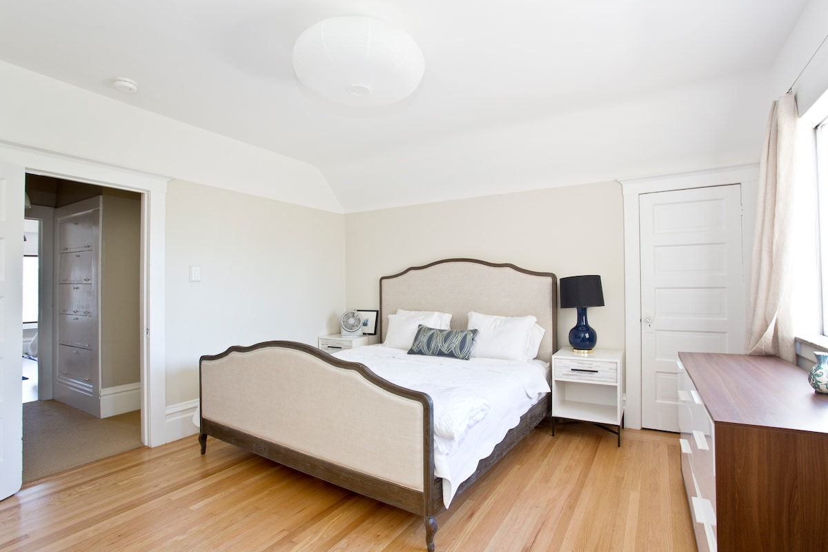 Beautiful master bedroom receives loads of light.  The organic tempur pedic bed is heavenly.