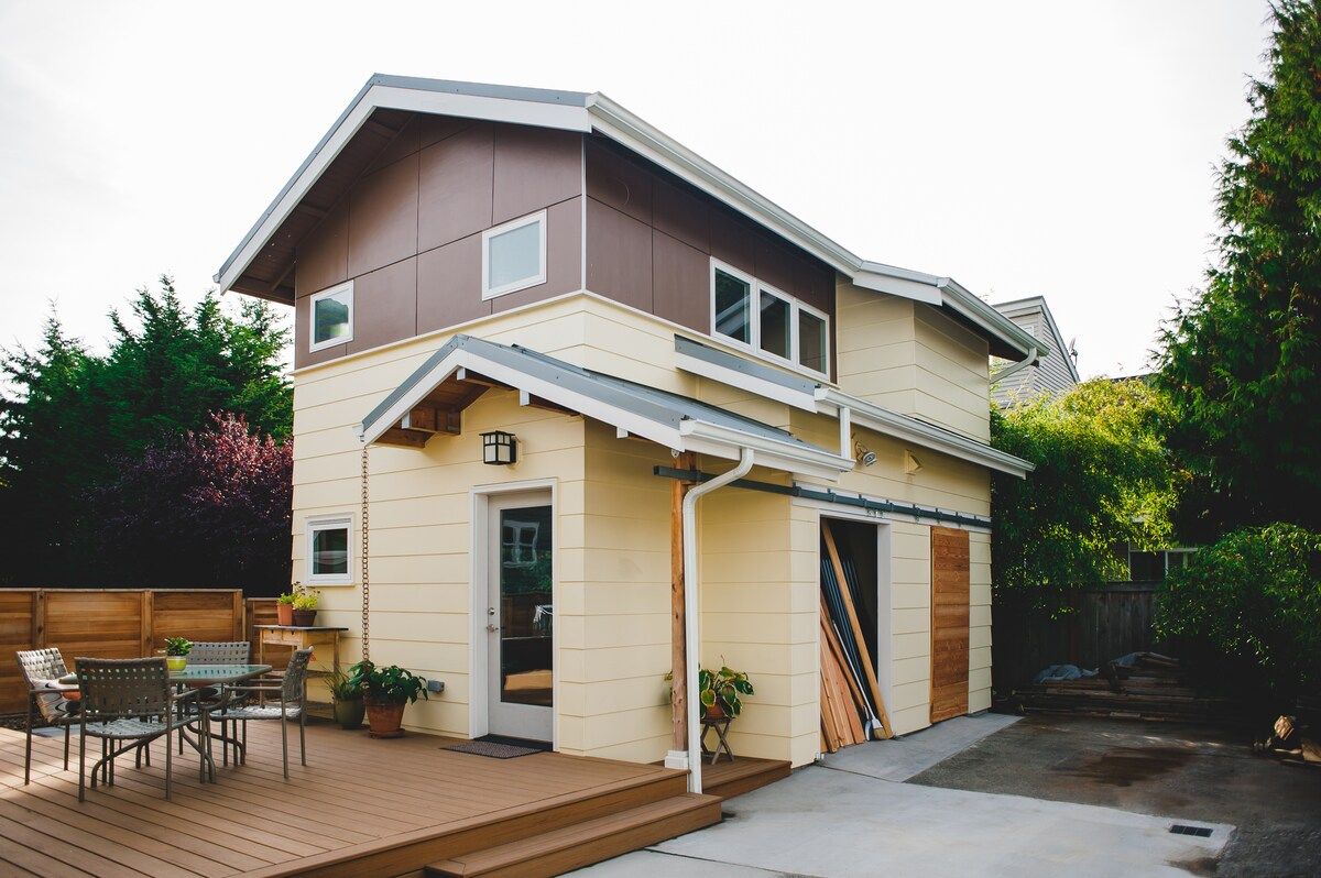 The beautiful, 2 story cottage sits behind our house, connected by a new deck with plenty of space to relax outdoors.