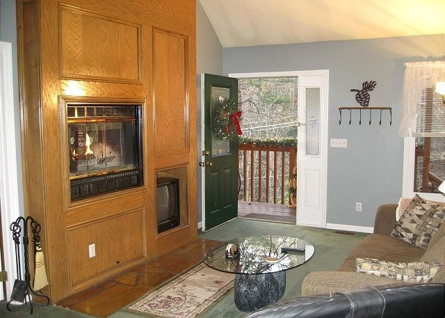 Real Wood Fireplace, firewood provided, 2 sided, see through, so fire is enjoyed from bedroom too. Leather Couch now here.