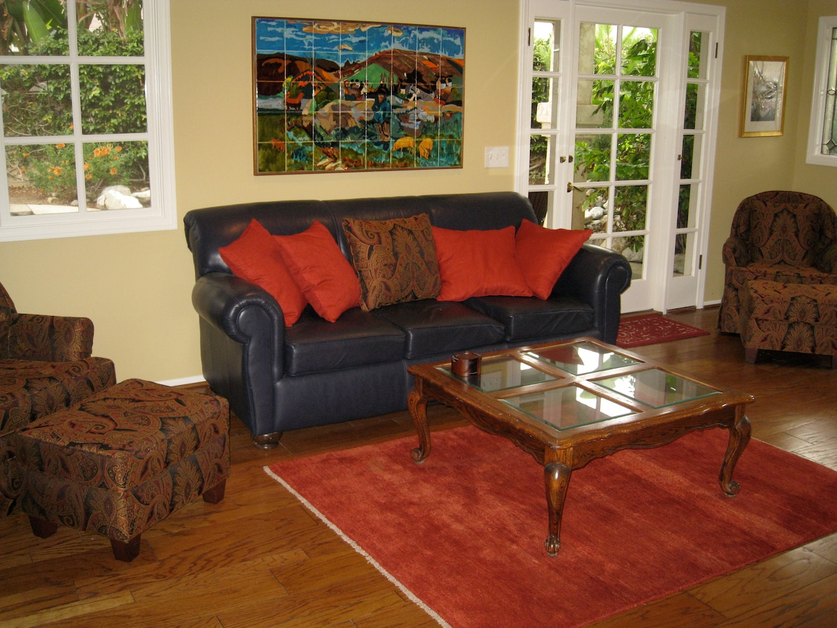 Downstairs family room, with fireplace and wide screen TV.