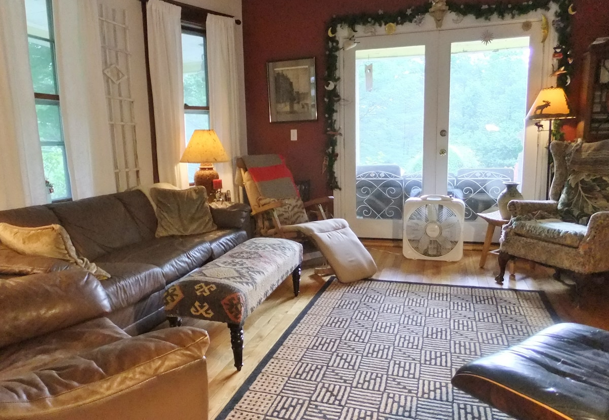 """Livingroom. great for """"Movie Night"""" DVD collection available for your use .lovely western view of white garden and sunsets."""