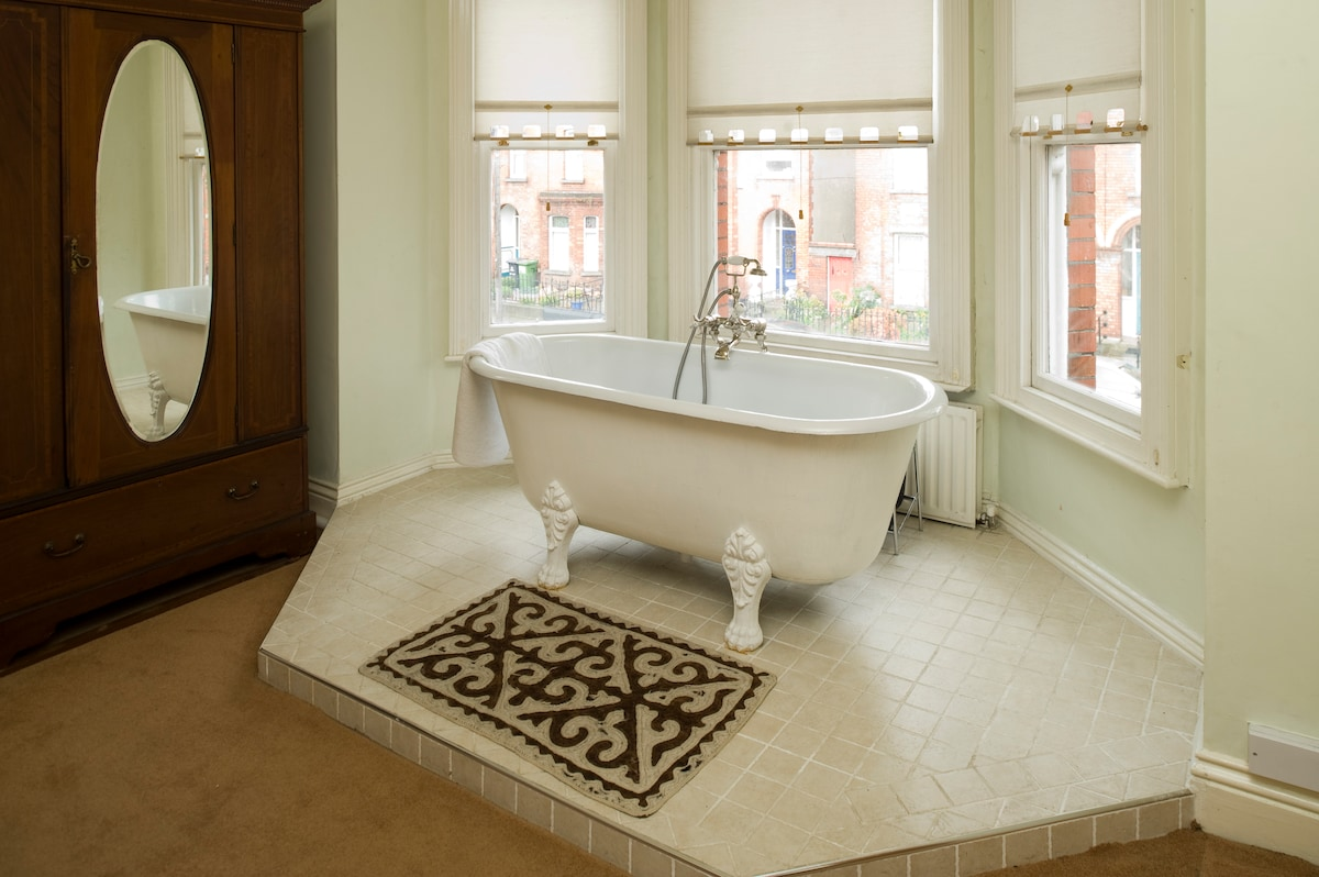 The deep, claw footed bath in the bay window is sheer luxury!