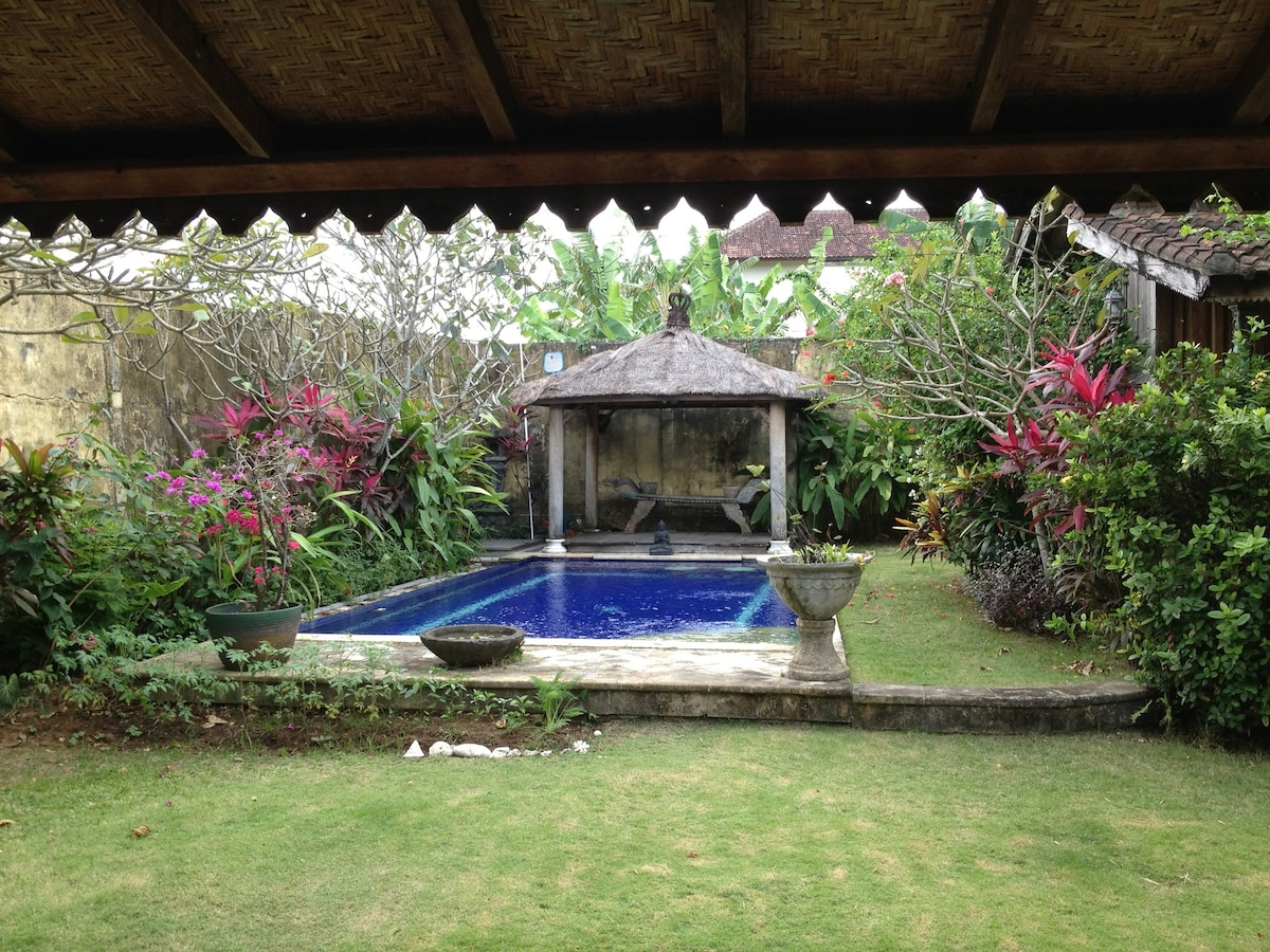 Private secluded garden with pool