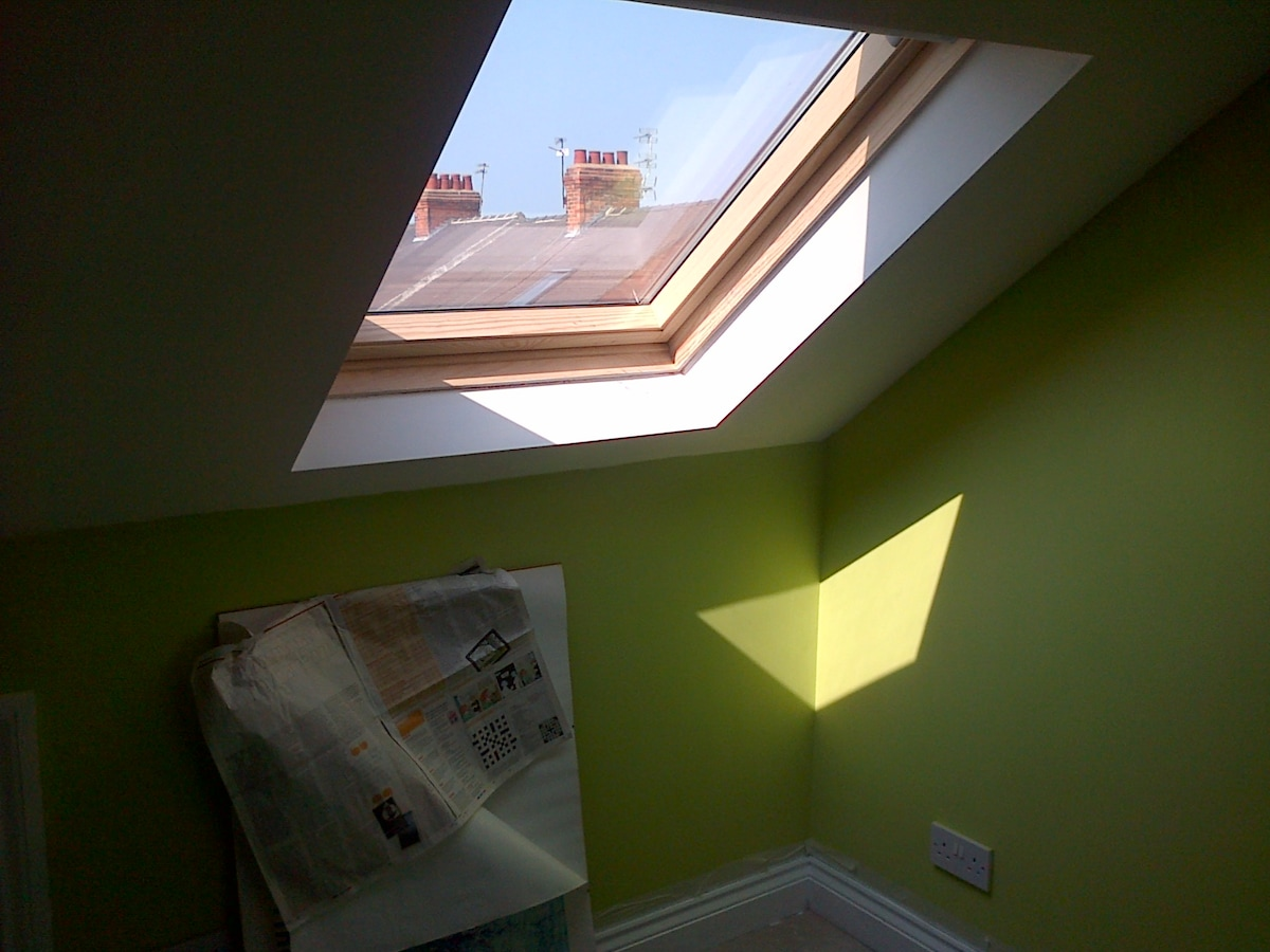 Loft ensuite with a view of green