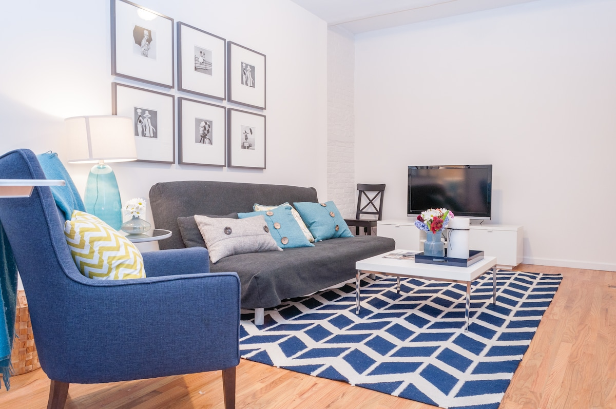 Spacious living room with cable and apple TV