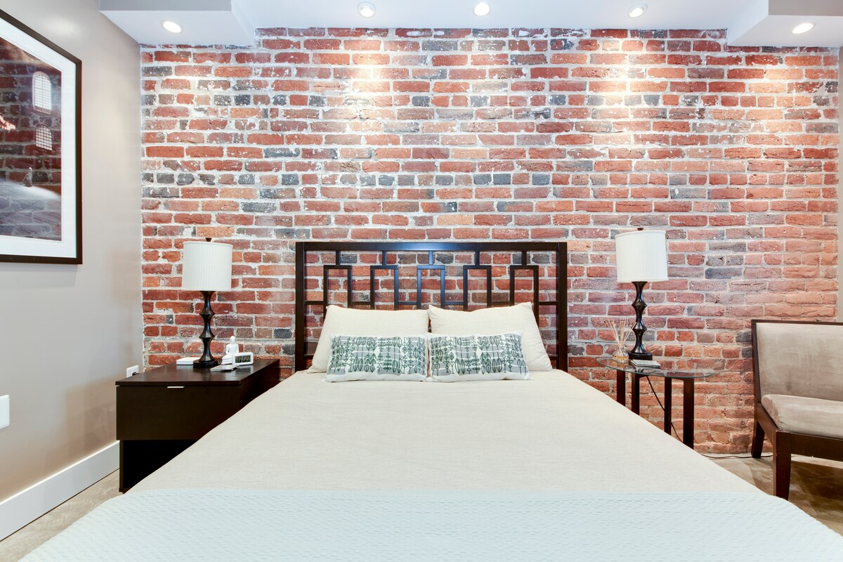 100-year-old brick wall complimented by modern decor
