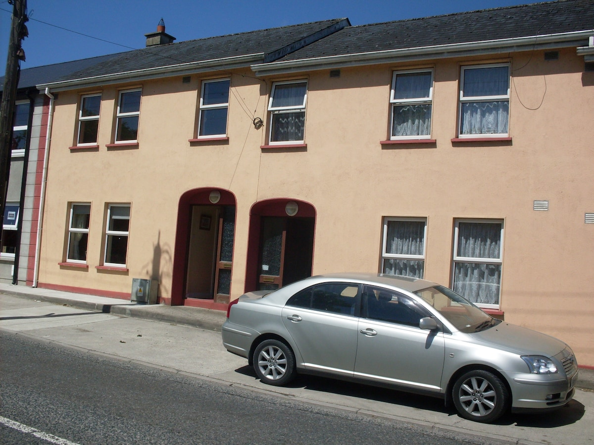 Erneside Townhouses Belturbet, House No 3 on left and House No. 2 on right with car in front of it.