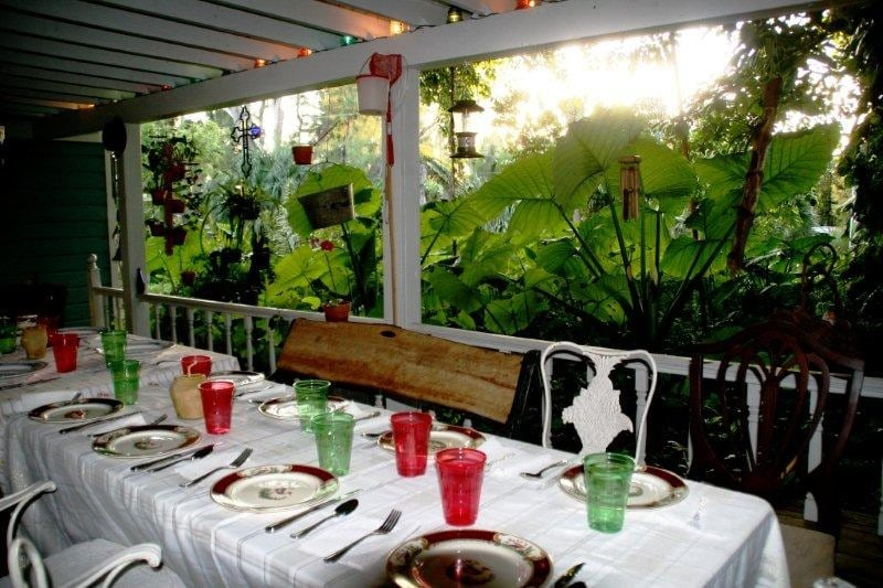 800 square ft front porch dressed for dinner for 23 overlooking the front yard and koi pond.