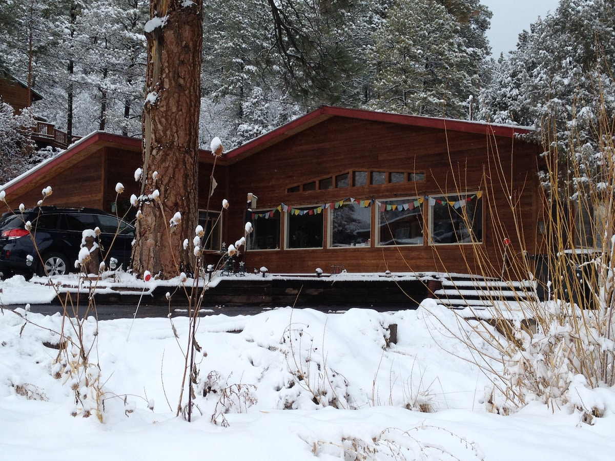 The house sits under a 350 year old Ponderosa Pine, the oldest in the valley. Your host lives in the studio on the left during your stay.