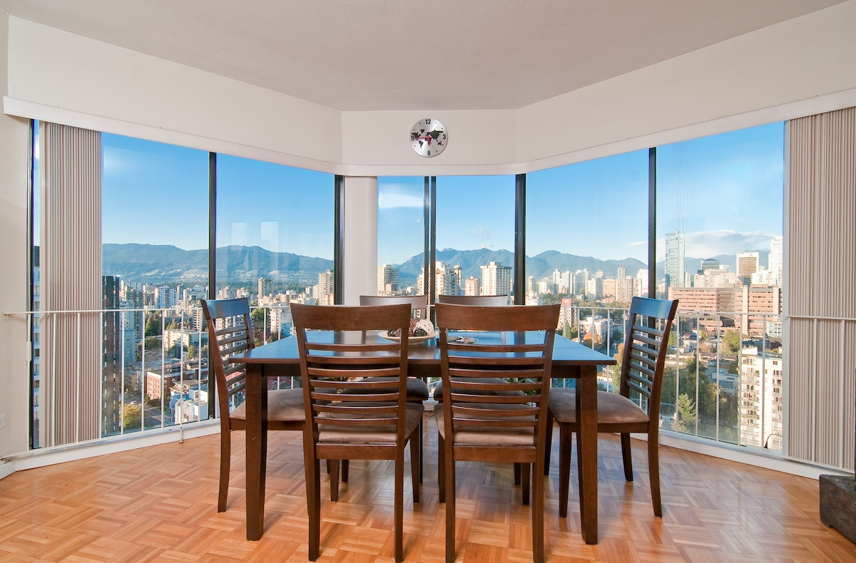 Dining table in the living room, with such unbeatable view of the ocean and downtown vancouver
