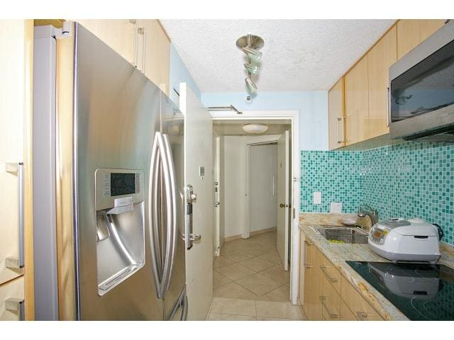 Full Kitchen, granite counters, new appliances. All kitchen-ware included. coffee maker, toaster oven, stove top