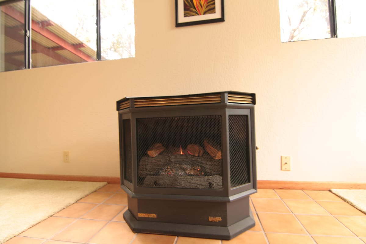 A nice and cozy fire in the propane fireplace in the living room.   A ceiling fan circulates warm air.