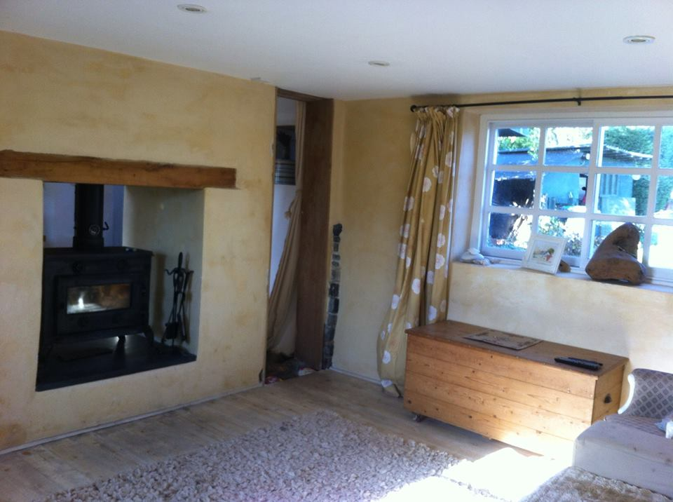 Open Plan living/dining room with double sided log burner.
