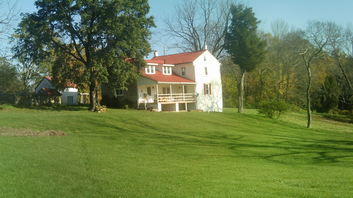 Farmhouse with inviting porch for relaxing and viewing wildlife.