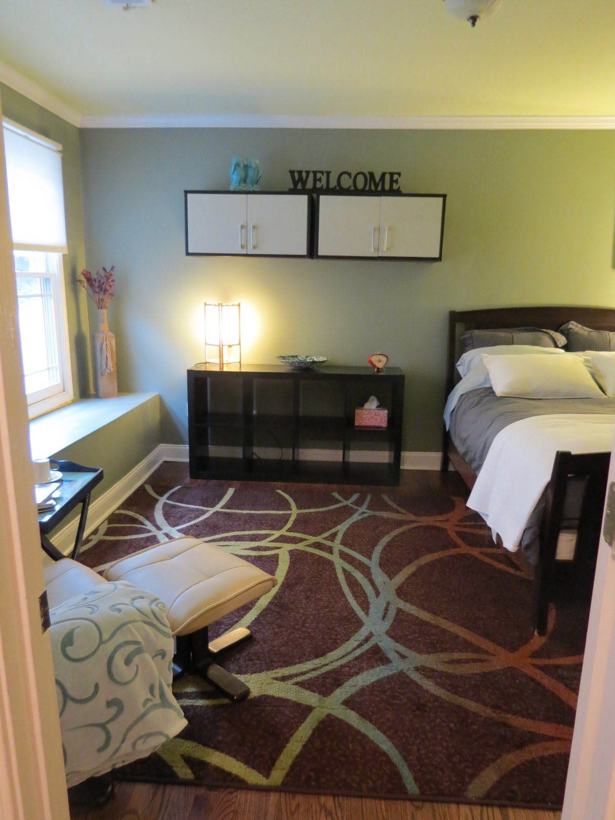 Spacious bedroom with Queen size bed & reading chair
