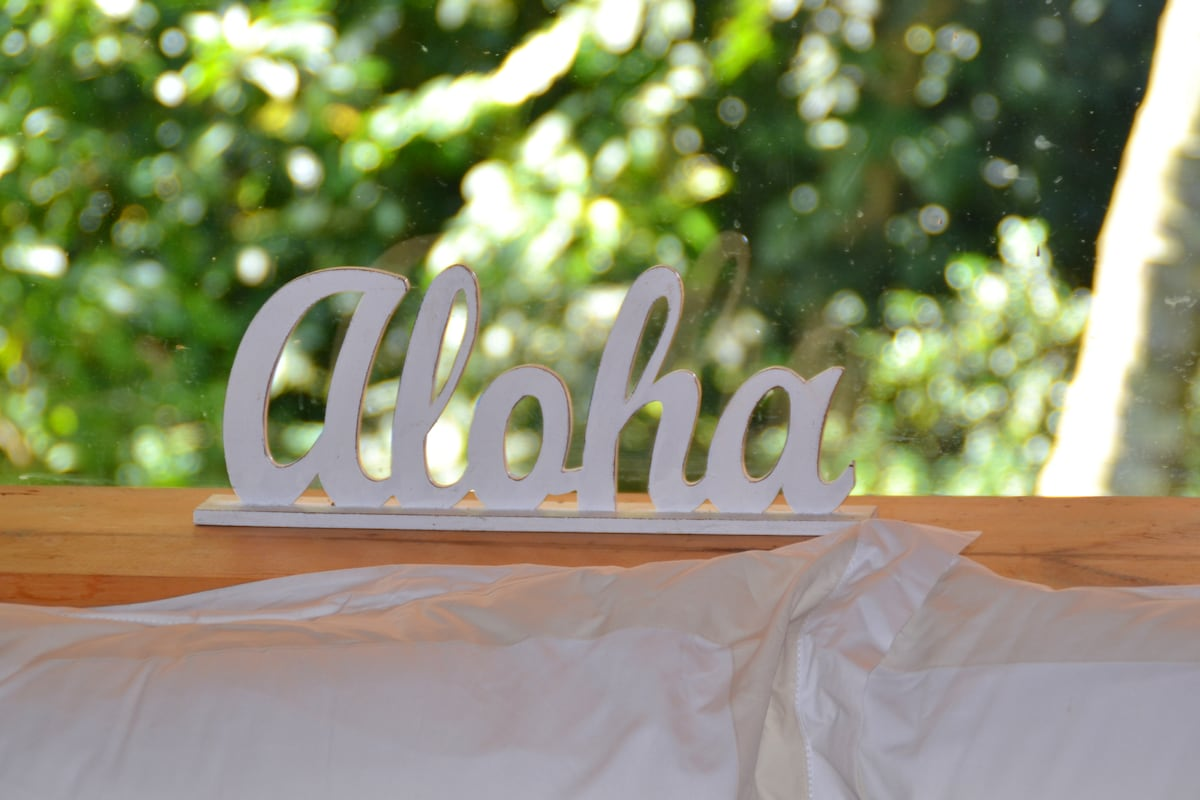 Aloha greets you at the head of your bed every night