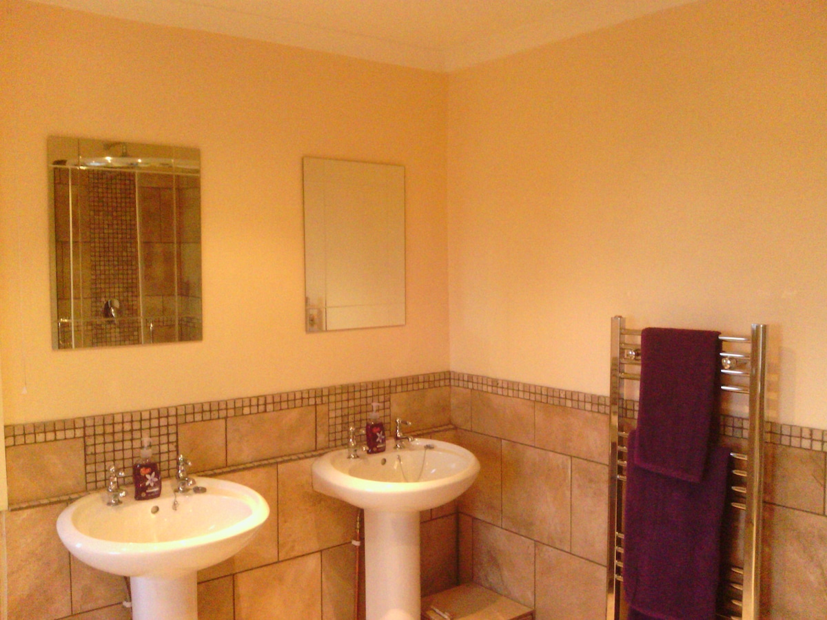 Private bathroom with twin sinks, separate shower and bath.  Towels provided.
