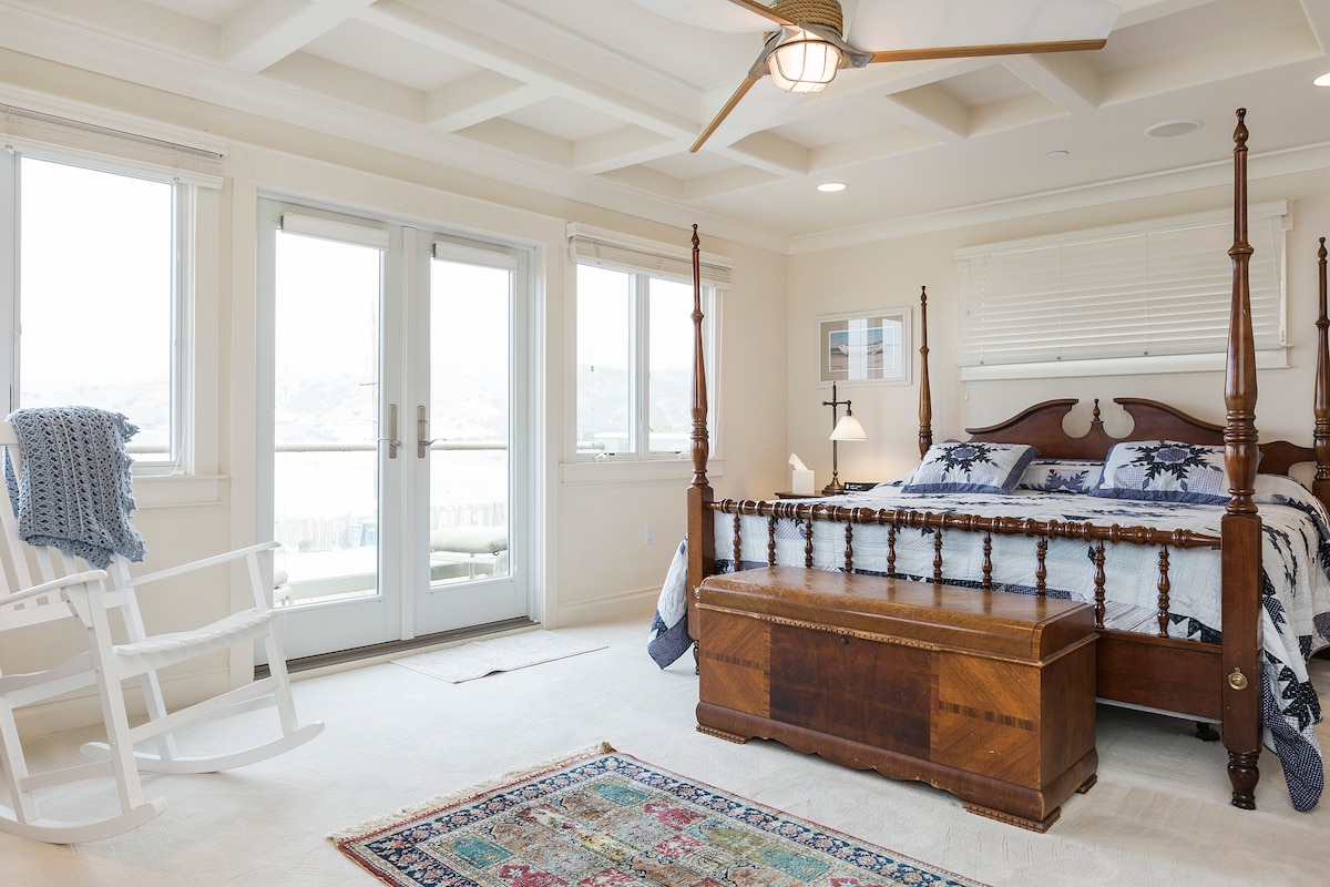 Master bedroom with deck overlooking the Pacific Ocean and Linda Mar Beach a popular surfing beach.