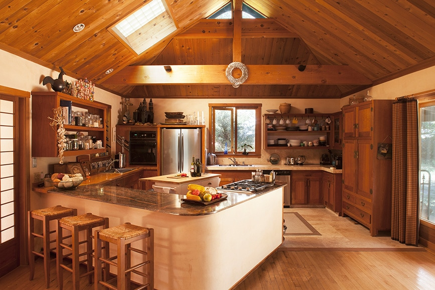 Designed for casual entertaining, the kitchen interacts with the dining area, tv nook, and den and occupies one end of the 1,000-square-foot Japanese-style pavilion. Equipment includes a dishwasher, two sinks, espresso machine, and ample counter space for