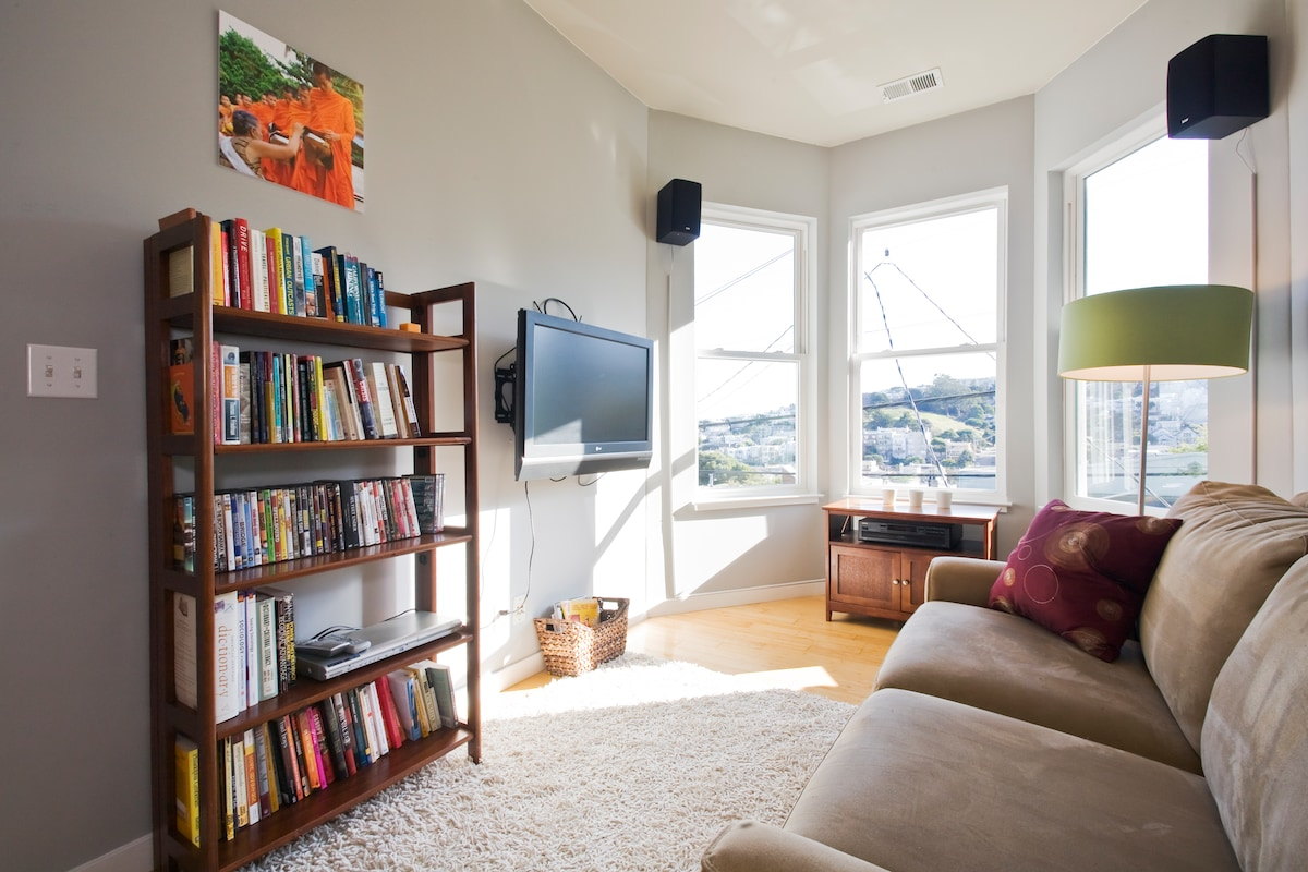 This is the front room - you can watch movies here, listen to music and look at the view at night, or just hang out