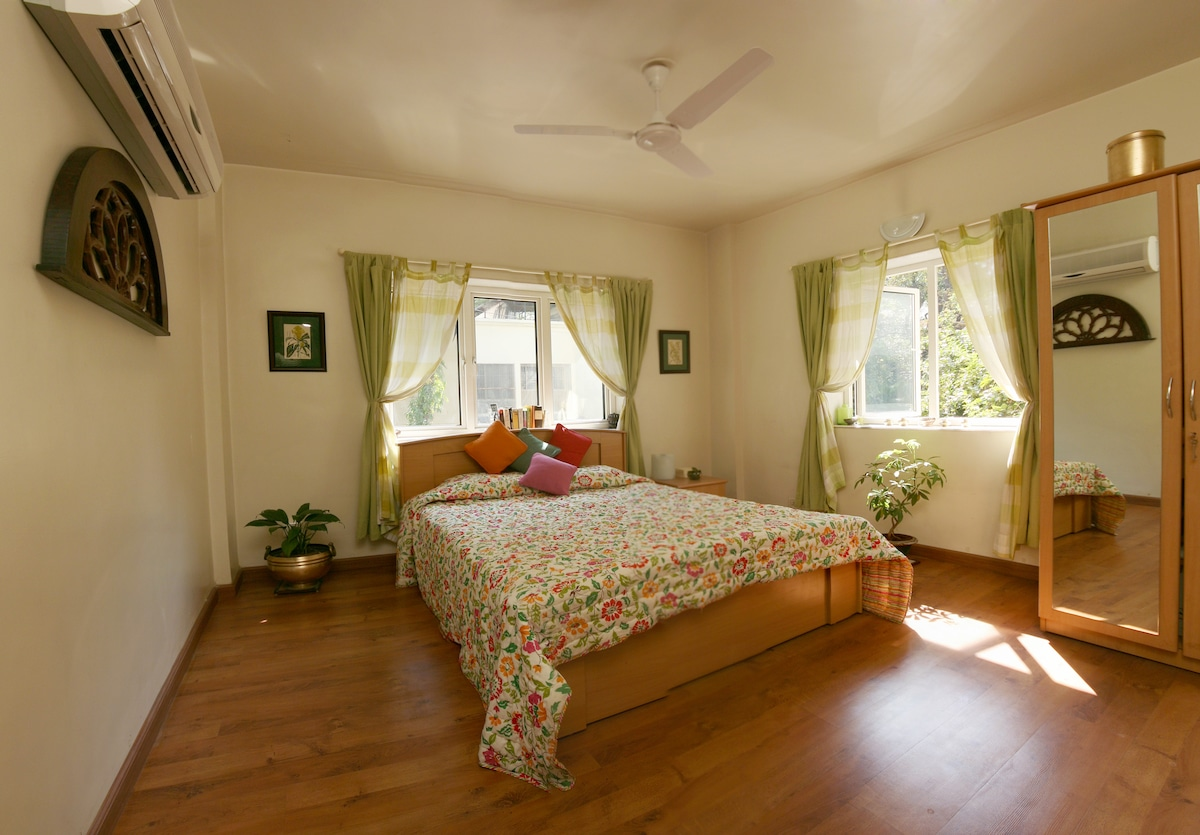 Spacious double room with AC, wardrobe tea and coffee making facilities.