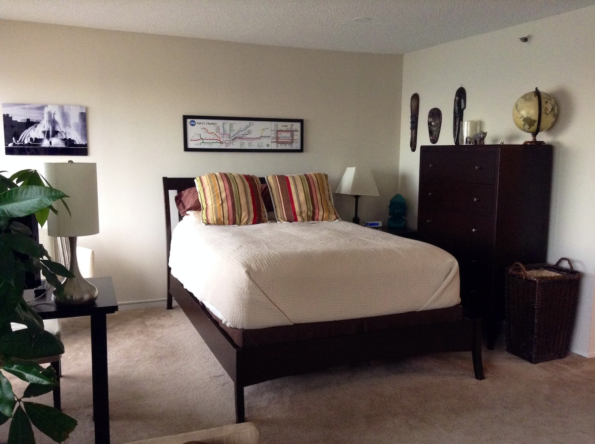 Queen bed comfortably accommodates 2 people.