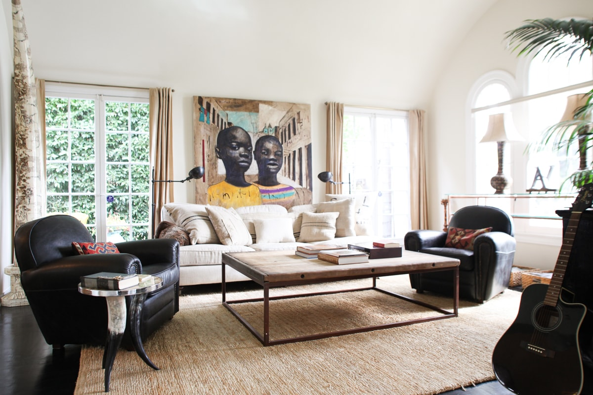 LIVING ROOM WITH CABLE TV AND 42' FLATSCREEN HIGH DEF, RESTORATION HARDWARE SEATING, VINTAGE AND ANTIQUE FURNITURE AND ART, LOTS OF LIGHT