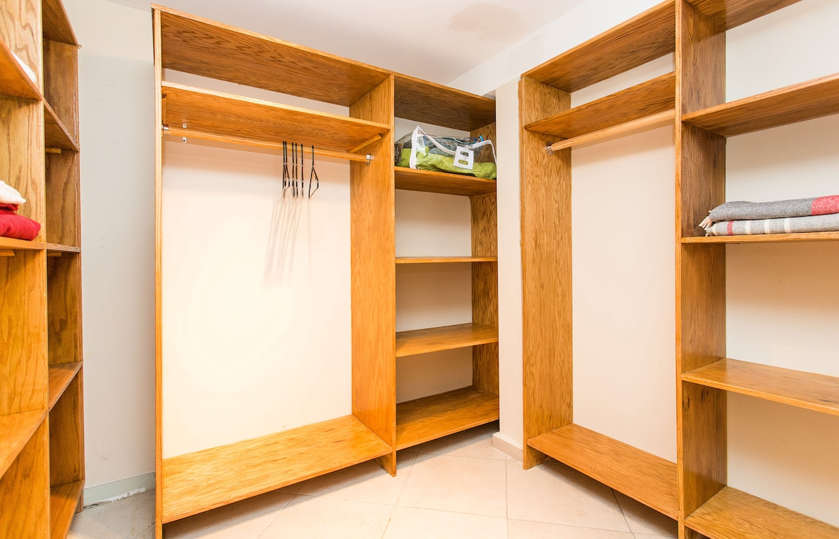 Huge walk-in closet with lots of space for luggage.