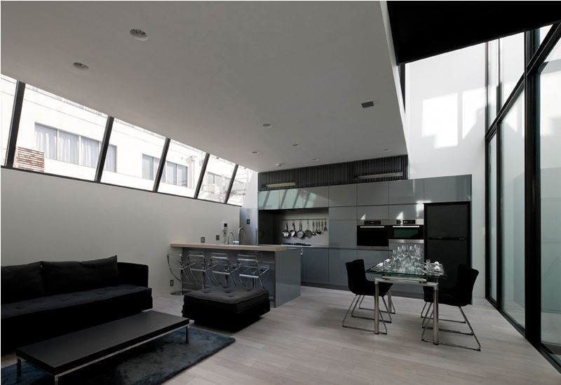 "The beautiful light filled open plan living, dining and kitchen room (""LDK"" in Japan). Furniture by Ligne Roset."
