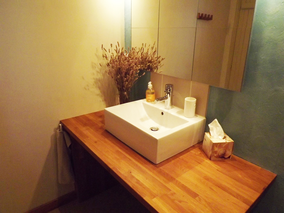 Guest bathroom has a bath with a shower over it, a WC and a wash basin (there is also a separate WC).