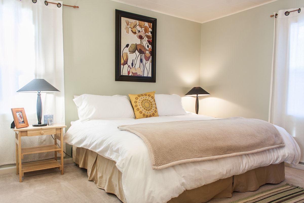 This tranquil master bedroom is located downstairs.  With a California King bed and luxury linens, you are sure to sleep well!