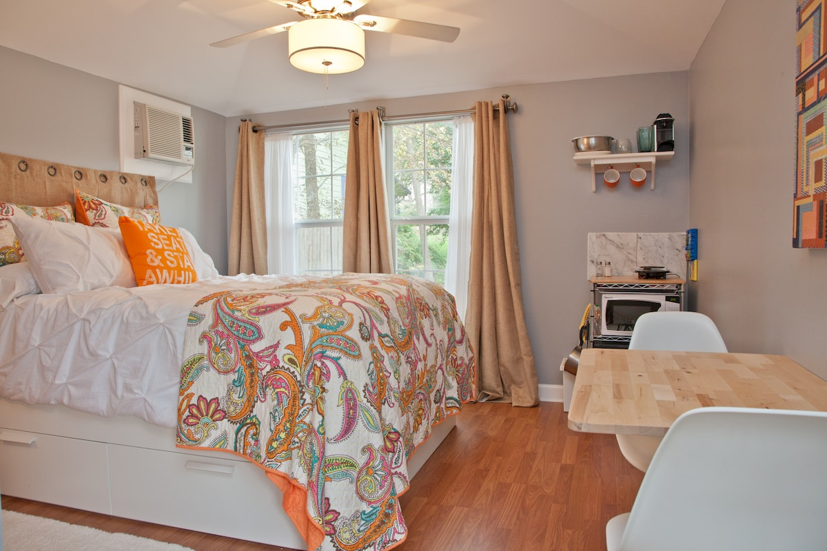 Expansive windows light up the comfortable bedroom. New ultra-quiet heating and cooling unit.