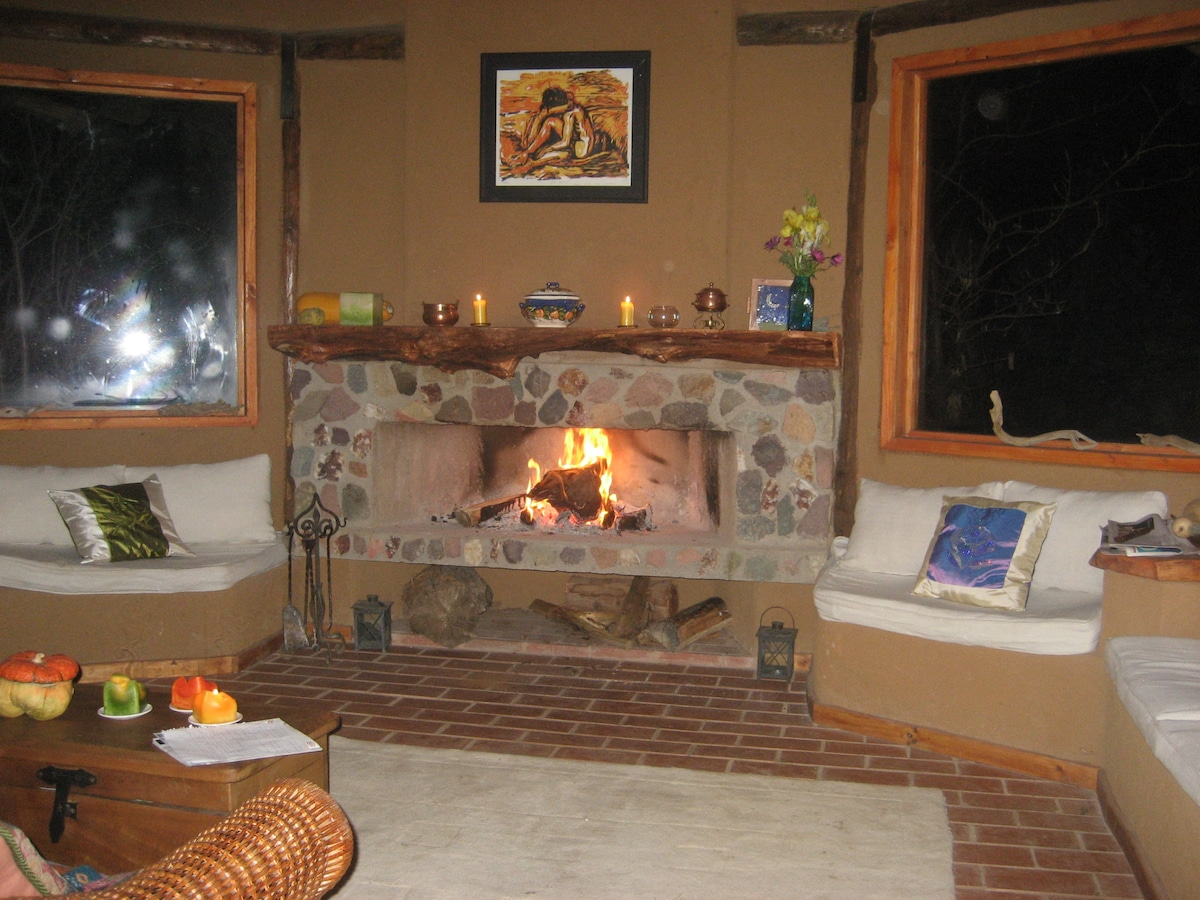 Main House. Living room with fireplace. Main room also has private fireplace.