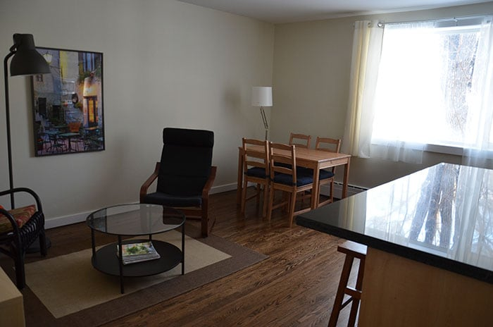 Living/dining room area. Open concept space. Plenty of sunlight. Cozy, simple, clean. Wi-fi, unlimited local phone, TV with cable.