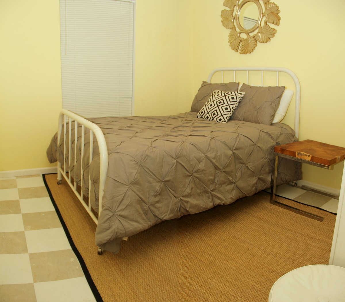 Guest Bedroom 2 - One full bed and full closet, also a large shelving unit to store your clothes.