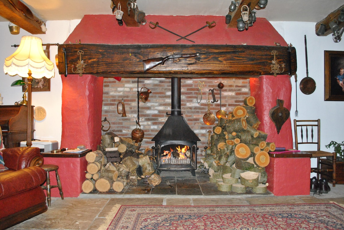 Inglenook fireplace in the sitting room - a wonderful heat radiates through our home