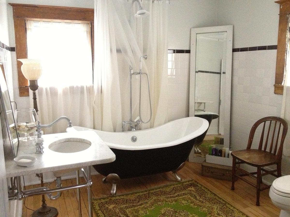Full shared bathroom with tub just steps from your bedroom.