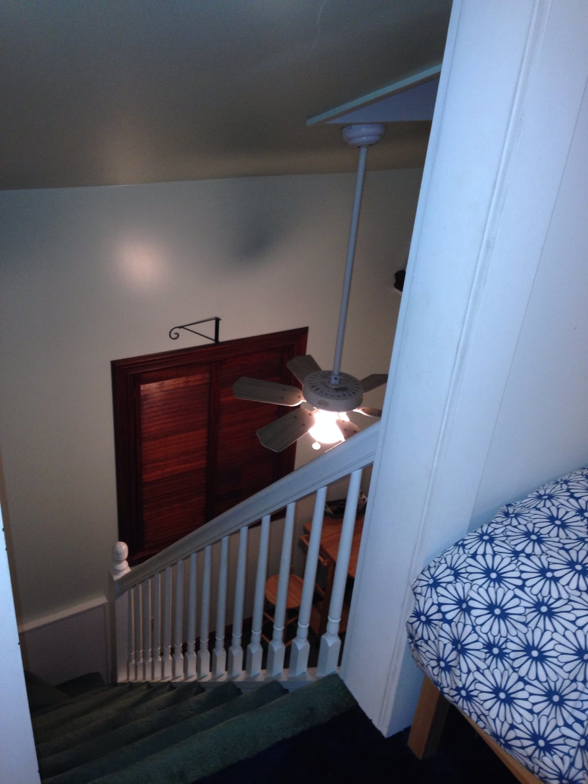 The view down from your third floor bedroom area (pictured in the first photo) and the second floor breakfast nook/den, all included in your private room.