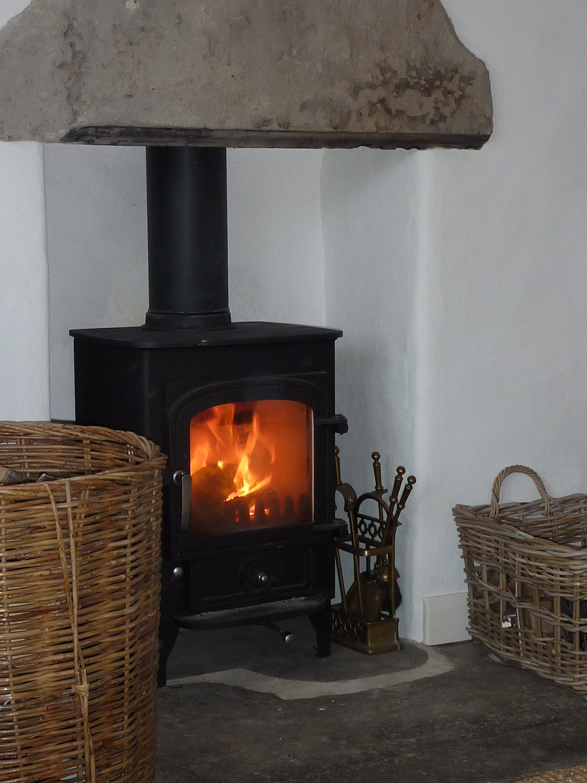 Get cosy by the wood-burner in the lounge