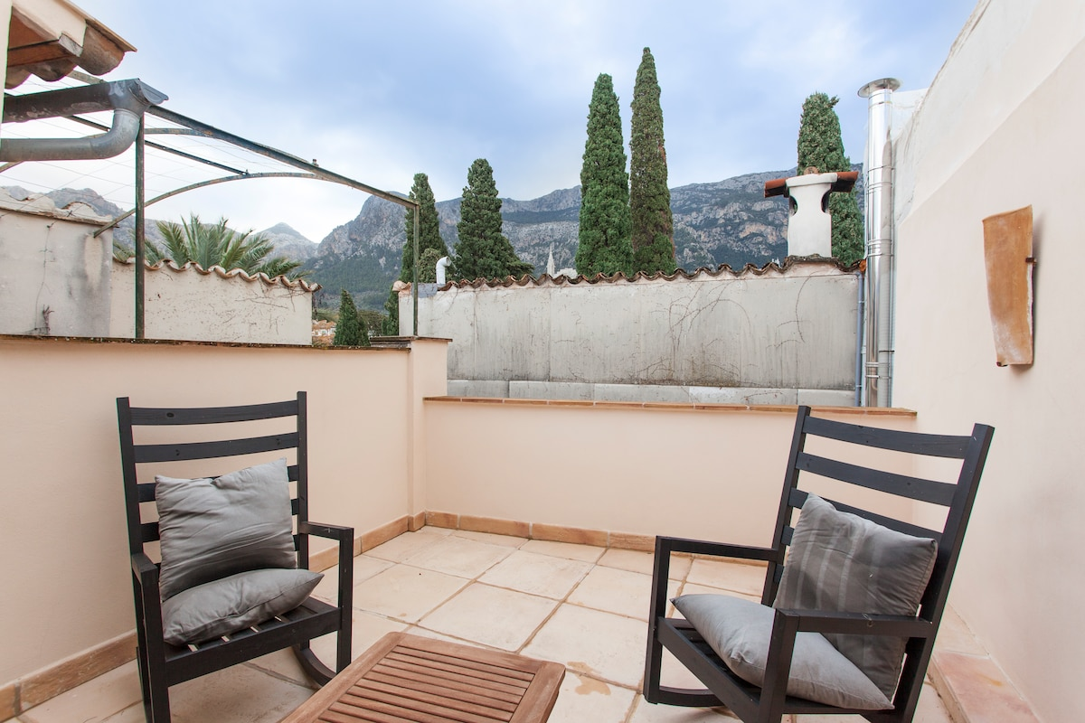 Private terrace with views to the mountains.