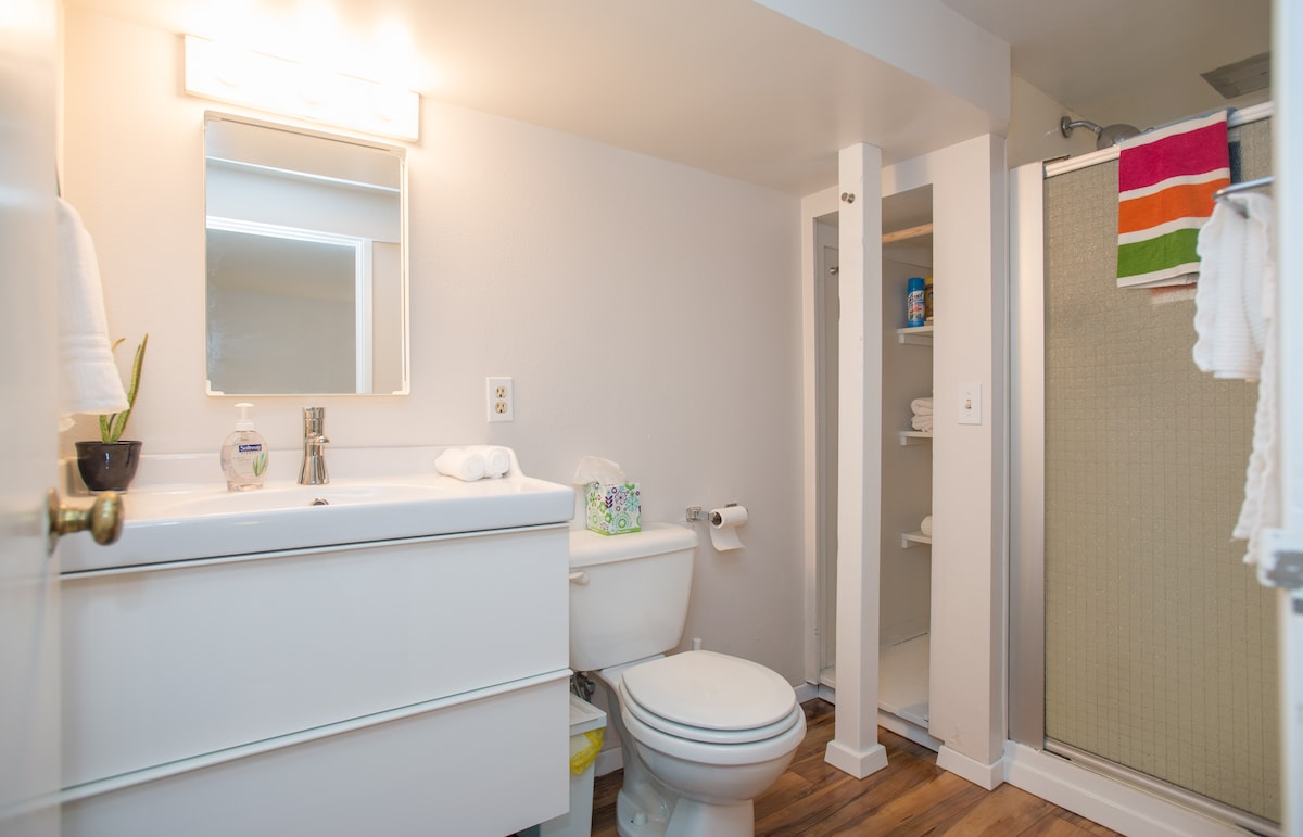 Bathroom with plenty of hooks and shelving for personal effects.