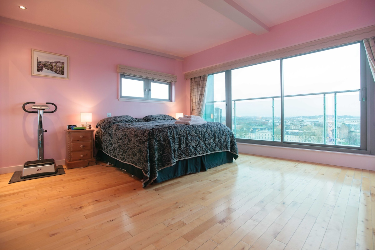 Master bedroom with super king size bed and view on the river Clyde.