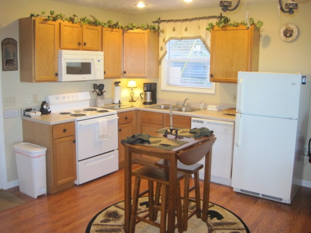 A fully equipped kitchen and dining area greet you upon arrival.