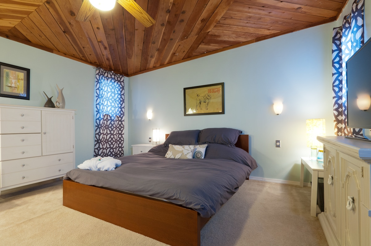 Beautifully appointed 14' x 13' master bedroom is a serene place to unwind.