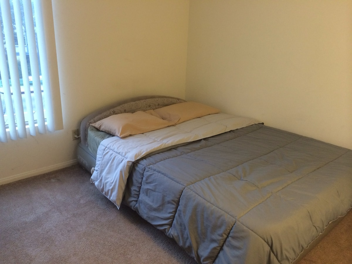Queen-size Aerobed air mattress available in a humble yet spacious guest room. Linen & blankets included.