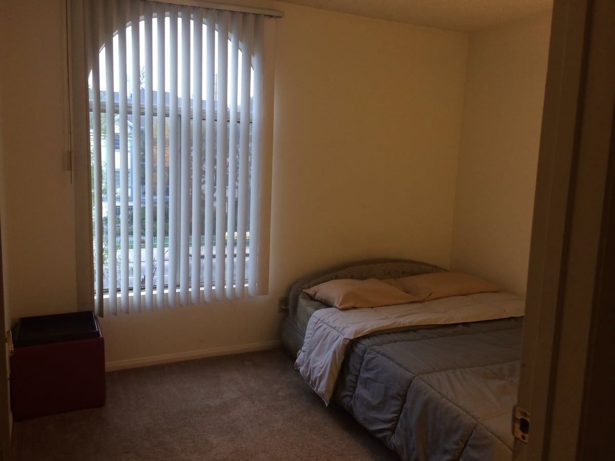 Guest room faces moderately busy street with plenty of natural light.