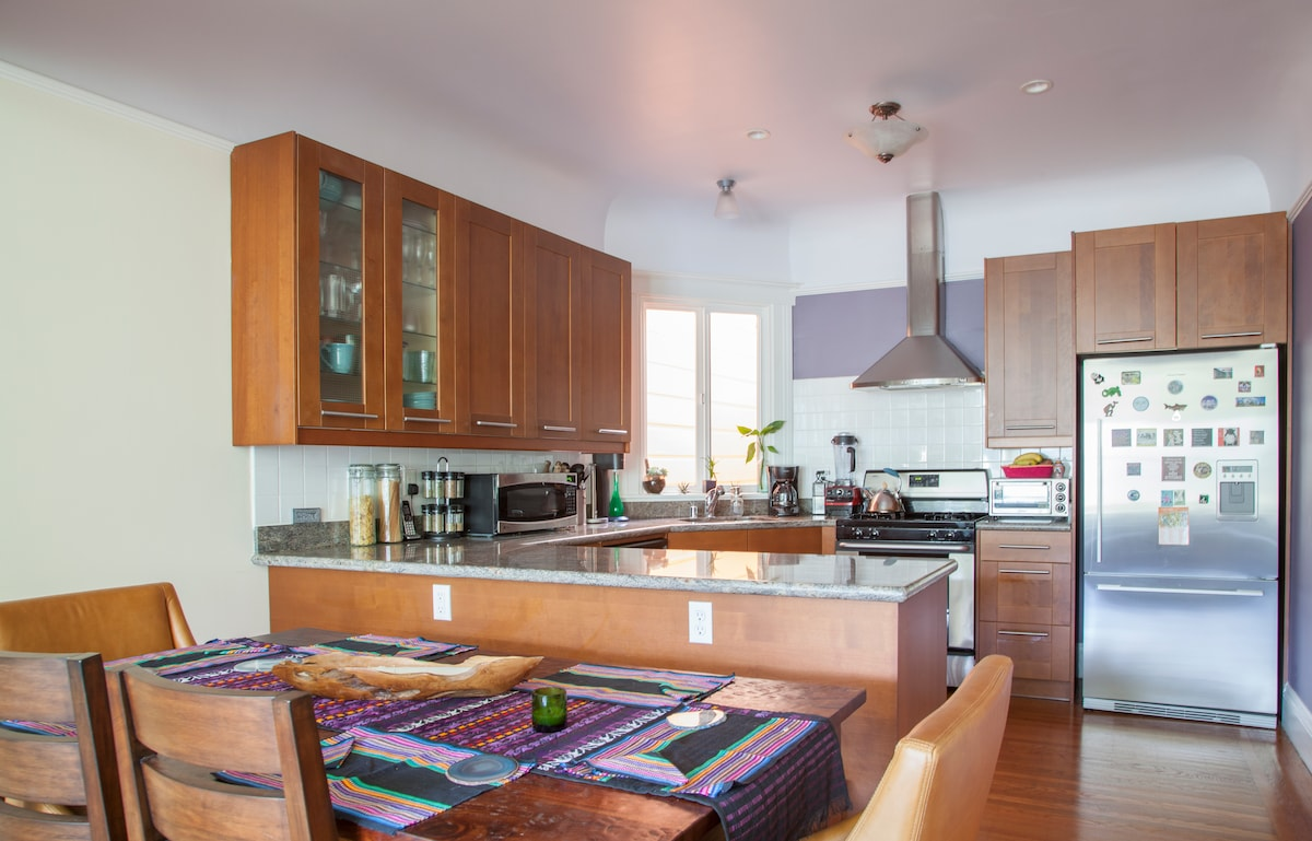 Dining area and kitchen with granite counter tops