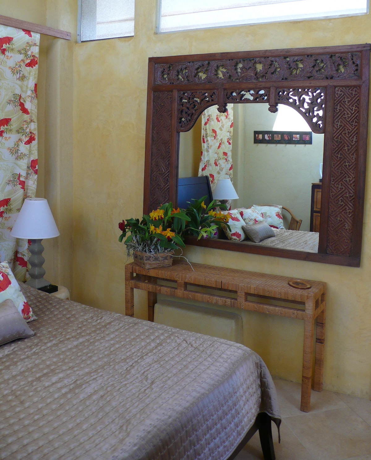 Partial view of guestroom with antique carved teak mirror