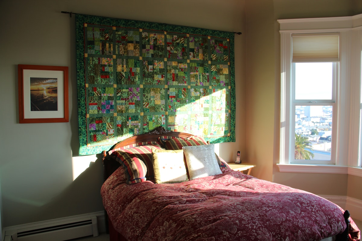 View from doorway with bright sunshine on new double bed mattress