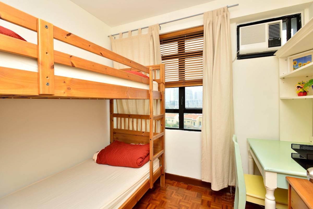 Comfy bunk bed with desk & dresser.